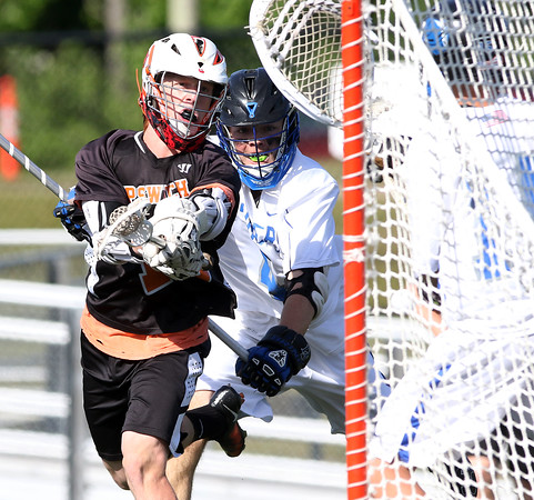 DAVID LE/Staff photo. Ipswich junior Duke Kriksceonaitis fires home a shot against Dover-Sherborn in the D3 State semifinal on Tuesday afternoon at Concord-Carlisle High School. 6/14/16.