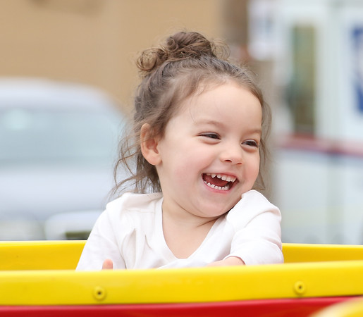 DAVID LE/Staff photo. Three-year-old Layci Figueroa, of Peabody, laughs while spinning around on a tea cup ride at the annual carnival held at Saint Vasilios Greek Orthodox Church on Saturday morning. 6/11/16.