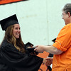 DAVID LE/Staff photo. Beverly High School graduate Carly Blau shakes hands with Kris Silverstein, President of the School Committee as she receives her diploma on Sunday afternoon. 6/5/16.