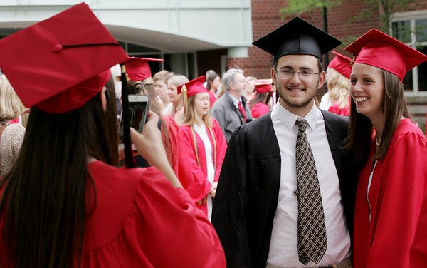 KEN YUSZKUS/Staff photo.   Marblehead High School graduates from left, Alyssa Nye, takes a photo of Nathan Faynzilberg, and Hadley Woodfin before the ceremony.     06/12/16
