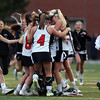 DAVID LE/Staff photo. The Marblehead girls lacrosse team mobs goalie Brittany Lydon after the Magicians defeated Ipswich 18-8 to capture the D2 North Title. 6/9/16.