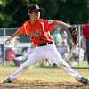 DAVID LE/Staff photo. Beverly relief pitcher Joe Brown throws a pitch against Danvers American on Wednesday evening. 6/29/16.