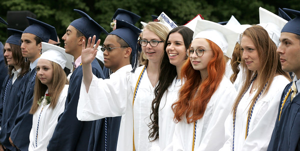 KEN YUSZKUS/Staff photo.    Peabody Veterans Memorial High School graduates wave to family and friends at the start of the graduation.       06/03/16