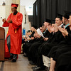 PAUL BILODEAU/Staff photo. Jhonel Roberts has a little fun introducing the class orator Simon Barats during Salem High School's graduation ceremony in the high school's field house.