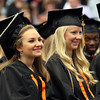DAVID LE/Staff photo. Beverly High School graduates Alexandra Lurie, left, and Melissa Lubas, laugh while listening to a speech by Salutatorian Samuel Peterson at graduation on Sunday afternoon. 6/5/16.