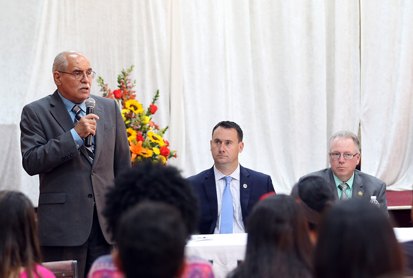 """DAVID LE/Staff photo. Rev. Claudio Lopes, introduces keynote speakers at a """"Love Should Not Hurt"""" Domestic Violence Awareness seminar held at Christ Community Church on Wednesday evening. Peabody Mayor Ted Bettencourt, and Peabody Police Chief Tom Griffin were among the speakers. 6/29/16."""