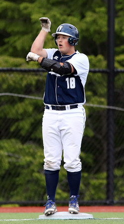 DAVID LE/Staff photo. Danvers sophomore Zach Dillon celebrates his leadoff triple in the bottom of the 6th inning of play. 6/9/16.