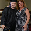 RYAN HUTTON/ Staff photo<br /> Northshore Recovery High School graduate James Geissler poses with school director Michelle Lipinski after receiving his diploma at the school's commencement ceremony at the Second Congregational Church in Beverly on Wednesday night.