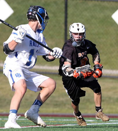 DAVID LE/Staff photo. Ipswich junior captain Kilian Morrissey tries to corral a loose ball before Dover-Sherborn sophomore Johnny Goudreault can reach it. 6/14/16.