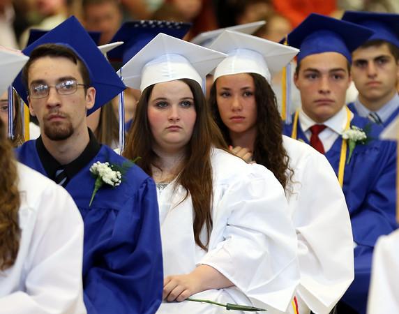 DAVID LE/Staff photo. Danvers graduates listen to classmate Tre Crittendon's speech on Saturday afternoon. 6/11/16.