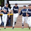 DAVID LE/Staff photo. Danvers players Zach Turner, Zach Sasso, Dean Borders and Max Paul, run out to greet senior captain Andrew Olszak, left, after the final out of the D2 North semifinal, a 6-3 Falcons win over North Andover. Olszak earned the win, and senior captain Danny Lynch hit two home runs and drove in four to lead the Falcons to the D2 North Final on Saturday. 6/9/16.