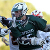 DAVID LE/Staff photo. Pentucket junior Ben Gardner tries to get through a double team from two Ipswich players on Friday evening in the D3 North Final. 6/10/16.