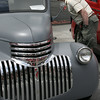 KEN YUSZKUS/Staff photo.    Paul Brooks of Boxford looks over a 1941 Chevy pickup truck at the antique car show held in Peabody.     06/12/16