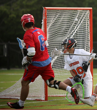 Beverly: During the North Division 2 playoff quarterfinal held at Endicott College on Saturday afternoon. Beverly beat Burlington 14-9. Beverly's Jacob Lopez, right, reacts to the goal just scored by Burlington's Danny Blase. Photo by Allegra Boverman