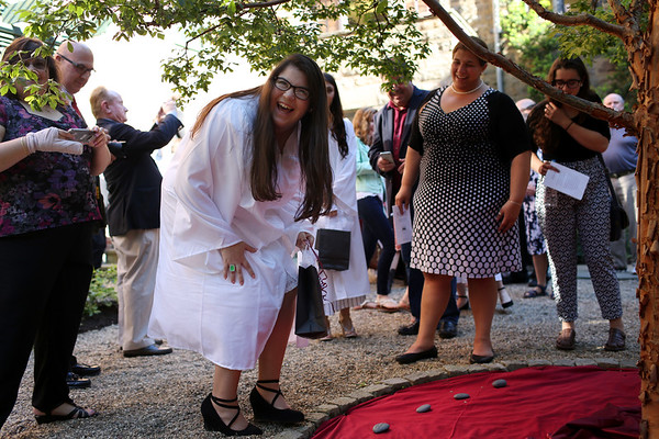 HADLEY GREEN/ Staff photo<br /> Veronica Sanchez of Lynn laughs after placing her engraved stone in The Academy at Penguin Hall's Legacy Garden. 6/09/17