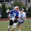 HADLEY GREEN/ Staff photo<br /> North's goalie Cameron Williamson (17) runs up the field while South's Tim Jordan (6) plays defense at the Agganis boys lacrosse all-star game at the Manning Field in Lynn. 6/28/17