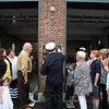 AMY SWEENEY/Staff photo.  Rev. Norman LaPointe blesses the newly dedication Joseph A. O'Keefe, Sr. Fire Station on 64 Loring Ave. in Salem. The building that houses Salem Fire Engine 5 was dedicated to Joseph O'Keefe, a beloved city official who died in September 2015. He had a long and celebrated tenure on City Council. O'Keefe also served as state fire marshal from 1977 to 1992.