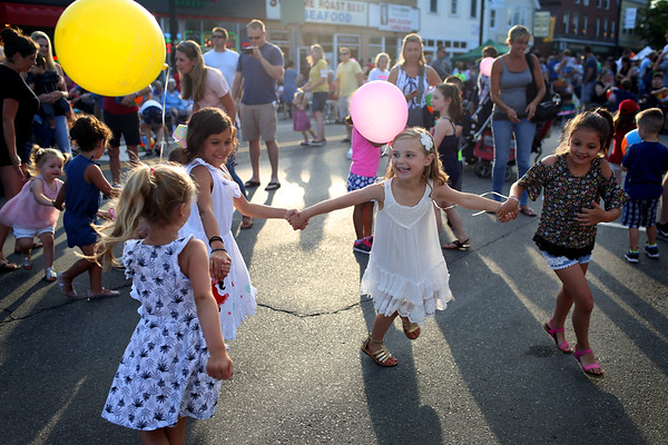 HADLEY GREEN/ Staff photo<br /> Children dance in the street at Oldies Night in Danvers Square. 6/28/17