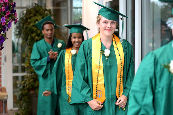HADLEY GREEN/ Staff photo<br /> Graduates walk into at Salem Academy Charter School graduation ceremony at the Salem Waterfront Hotel. 6/16/17