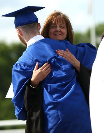 HADLEY GREEN/ Staff photo<br /> Danvers High principal Susan Ambrozavitch hugs Kyle Drummey at the Danvers High School graduation. 6/10/17