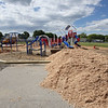 New playground structure has been installed and 375 yards of mulch being spread at new play space