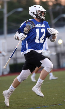 HADLEY GREEN/ Staff photo<br /> North's Daniel Muller (12) runs up the field at the Agganis boys lacrosse all-star game at the Manning Field in Lynn. 6/28/17