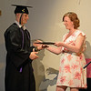 RYAN HUTTON/ Staff photo<br /> New Liberty Innovation School graduate Curtis Buttner receives his diploma from PrincipalJennifer Winsor at the school's graduation ceremony at the Salem YMCA's Ames Hall on Thursday