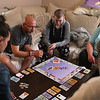 HADLEY GREEN/ Staff photo<br /> Kyle O'Grady plays monopoly with his family and Care Dimensions staff at his family's home in Danvers. 6/01/17
