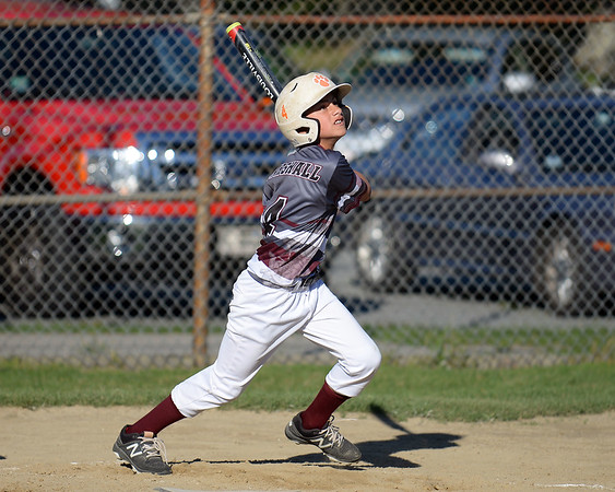RYAN HUTTON/ Staff photo<br /> Gloucester's Emerson Marshall watches the ball he just hit sail during the top of the third inning of Wednesday's game against Danvers at Boudreau Field in Gloucester.