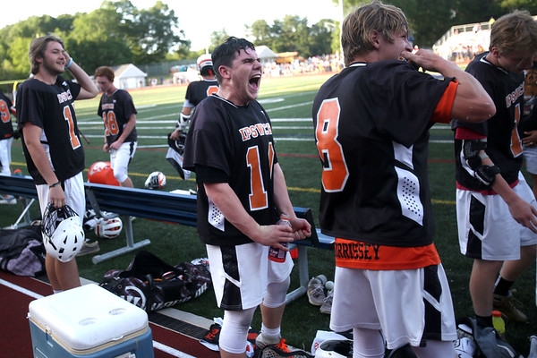 HADLEY GREEN/ Staff photo<br /> Ipswich's Pat Gillis (10) celebrates with his teammates after winning against Hanover. 6/14/17