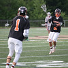 HADLEY GREEN/ Staff photo<br /> Beverly's Kyle Chouinard (2) passes the ball to teammate Nick DiLusio (1) at the Wakefield v. Beverly Division 2 North championship boys lacrosse game held at Concord-Carlisle High School in Concord. 6/10/17