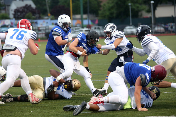 HADLEY GREEN/ Staff photo<br /> North's Drew Gally (12) of Marblehead is tackled from South defenders on all sides at the Agganis boys football all-star game at the Manning Field in Lynn. 6/28/17