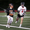 HADLEY GREEN/ Staff photo<br /> Beverly's Justin Loreti (15) runs with the ball while Hingham's Marc O'Rourke (6) plays defense at the Hingham v. Beverly boys lacrosse Division 2 state semifinals. 6/14/17