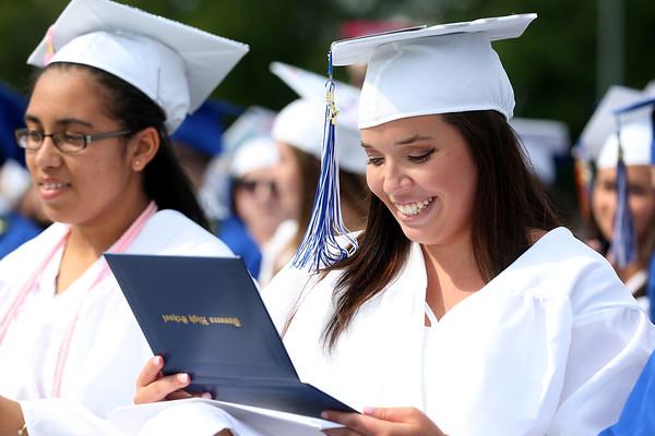 HADLEY GREEN/ Staff photo<br /> Melanie Litchfield admires her diploma at the Danvers High School graduation ceremony. 6/10/17