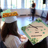 HADLEY GREEN/ Staff photo<br /> Students' decorated caps were visible at The Academy at Penguin Hall's inaugural graduation ceremony. 6/09/17