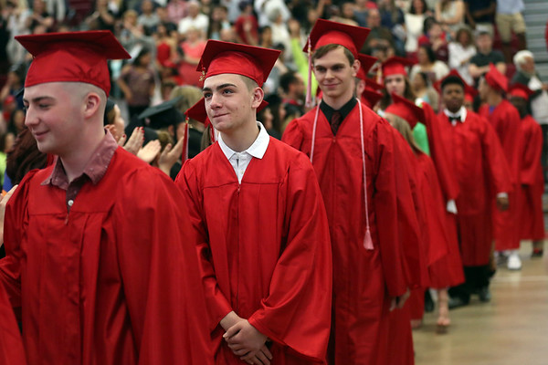 HADLEY GREEN/ Staff photo<br /> Graduates enter the Salem High School graduation ceremony. 6/02/17