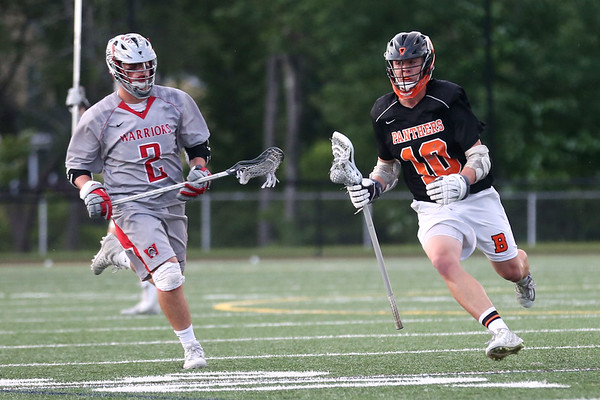 HADLEY GREEN/ Staff photo<br /> Beverly's Chris Cole (10) runs with the ball while Wakefield's P.J. Iannuzzi (2) defends him at the Wakefield v. Beverly Division 2 North championship boys lacrosse game held at Concord-Carlisle High School in Concord. 6/10/17