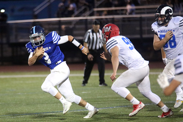 HADLEY GREEN/ Staff photo<br /> North's Lewi L'Heureux (3) of Triton runs from South defenders at the Agganis boys football all-star game at the Manning Field in Lynn. 6/28/17