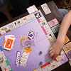 HADLEY GREEN/ Staff photo<br /> Kyle O'Grady plays monopoly with his family at their home in Danvers. 6/01/17