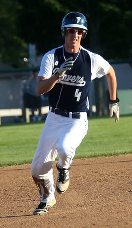 HADLEY GREEN/ Staff photo<br /> Danvers' Max Paul (4) runs from second to third base at the Danvers v. Woburn Division 2 North first round state tournament boys baseball game held at the Twi Field in Danvers. 6/01/17