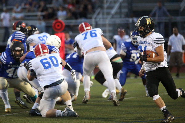 HADLEY GREEN/ Staff photo<br /> South's Austin Perrin (31) of Northeast Reg. runs with the ball at the Agganis boys football all-star game at the Manning Field in Lynn. 6/28/17
