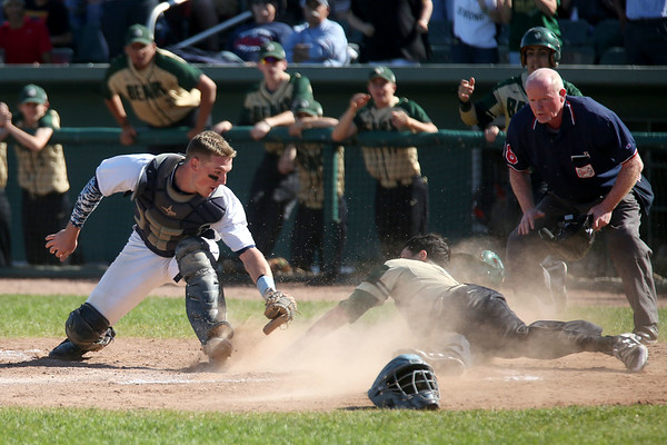 HADLEY GREEN/ Staff photo<br /> Danvers' catcher Matt Andreas (10) goes to tag Greater New Bedford's Tyler Horton (10) at the Greater New Bedford v. Danvers  Division 2 state baseball championship game at the Campanelli Stadium in Brockton. 6/15/17