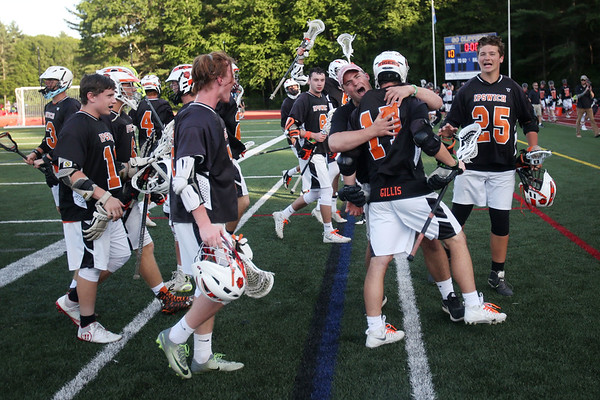 HADLEY GREEN/ Staff photo<br /> Ipswich players celebrate after winning the boys lacrosse Division 3 state semifinals game at Norwell High School in Norwell, Massachusetts. 6/14/17