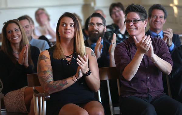 HADLEY GREEN/ Staff photo<br /> Northshore Recovery High School alum Rebecca Murray sits with teachers and community members at the Northshore Recovery High School graduation ceremony held at the Second Congregational Church in Beverly. 6/07/17