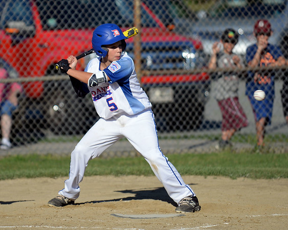 RYAN HUTTON/ Staff photo<br /> Danvers' Aaron Blum eyes an incoming pitch during the bottom of the second inning of Wednesday's game against Gloucester at Boudreau Field in Gloucester.