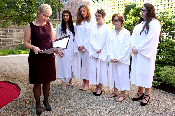 HADLEY GREEN/ Staff photo<br /> School president Molly Martins speaks at The Academy at Penguin Hall's inaugural graduation ceremony in the school's Legacy Garden. 6/09/17