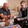 HADLEY GREEN/ Staff photo<br /> Kyle O'Grady plays monopoly with his father, Brett Desrosier, at their home in Danvers. 6/01/17