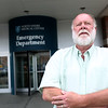HADLEY GREEN/ Staff photo<br /> Recovery coach Jimmy Billings stands outside the Salem Hospital emergency room. 6/01/17