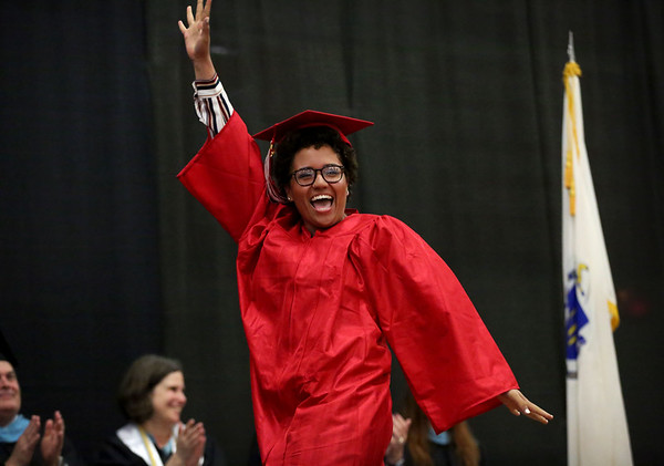 Staff photo/ HADLEY GREEN<br /> Kairys Lopez walks across the stage to receive her diploma at the Salem High School graduation ceremony. <br /> <br /> 06/01/2018