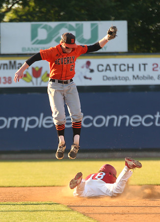 Staff photo/ HADLEY GREEN<br /> Beverly's Tim McCarthy (2) leaps for the ball while North Attleborough's Brendan McHugh (18) slides into second during the Division 2 state championship game at LeLacheur Park.<br /> <br /> 06/21/2018